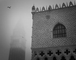 Europe, Italy, Venice. The Doge's Palace and Campanile in the mist. Credit as