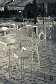 Italy, Brescia Province, Sirmione. Lakeside cafe tables