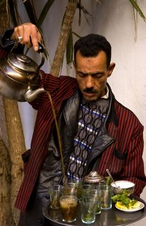 Man pouring tea for sale in Medina area of Tunis Tunisia of Northern Africa
