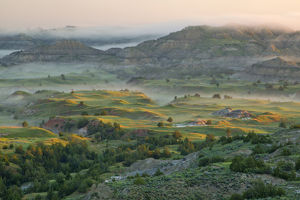 Morning fog on the badlands at Theodore Rooosevelt National Park, North Dakota, USA