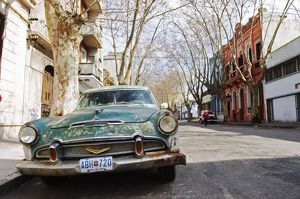 cars/old car rusty flaky colour parked street green