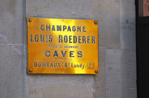 polished brass sign winery louis roederer saying