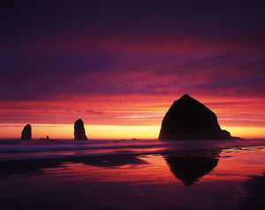 USA, Oregon, Oregon Coast, View of Haystack Rock on Cannon beach at sunset