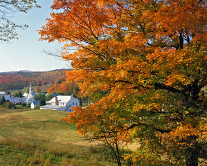 USA, Vermont, East Corinth. Fall colors framing church and town. Credit as: Steve