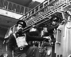 Auxiliary Fire Service crew with fire engine, WW2