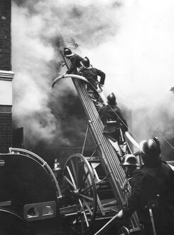 Firefighters in action, Eagle Street, London WC1