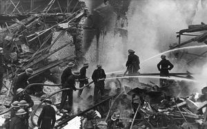 Firefighters in action after flying bomb attack, WW2