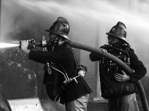 Two firefighters at King George V Dock, East London