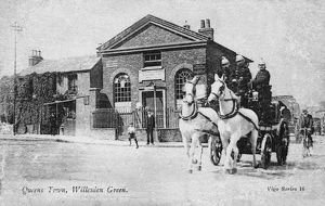 Horse-drawn fire engine with crew, Willesden, London