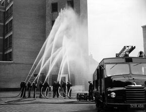 LFB firefighters in multi-hose display