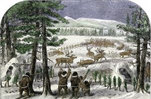 Native Americans herding reindeer in Alaksa