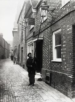 Lamplighter in Lombard St., Petworth, 1931