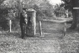 Postman emptying the letterbox, 1960