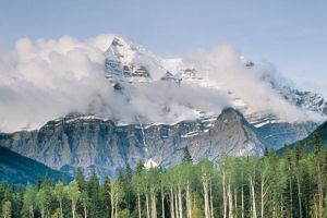 Cloud shrouded Mt Robson in Canadian Rockies in Sept. Mt. Robson Prov.Pk BC Canada