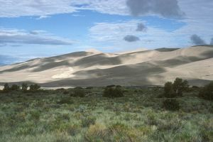 Great Sand Dunes Natl Monument - Colorado Medano Creek separates dunes from grassland