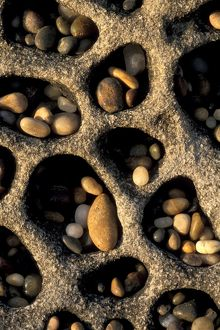 Small smooth Stone Rock Pebbles caught in wind formed Tafoni Formation