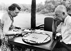 (1890-1969). 34th President of the United States. Eisenhower and his wife, Mamie, playing Scrabble