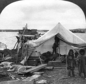 ALASKA: ESKIMO CAMP, c1905. A Malamut Indian camp on the Yukon in Alaska, with