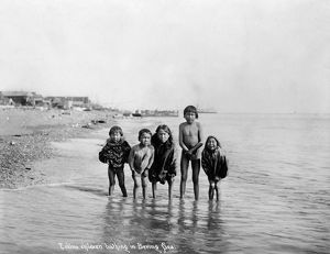 ALASKA: ESKIMO CHILDREN. Five Eskimo children wading in the water in the Bering Sea