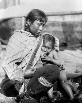 ALASKA: ESKIMOS, c1908. An Inuit woman breast-feeding her child, Alaska. Photograph