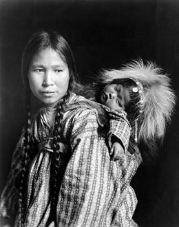ALASKA: ESKIMOS, c1912. An Inuit woman with a child on her back, Alaska. Photograph
