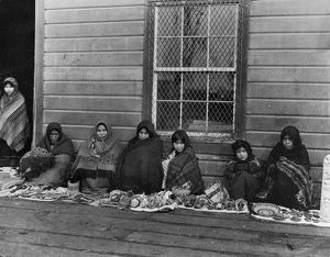 ALASKA: TLINGIT WOMEN, 1905. Tlingit women and girls displaying handcrafted items