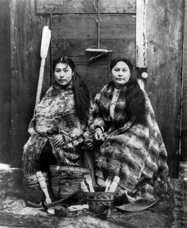 ALASKA: TLINGIT WOMEN, c1900. Two Tlingit women, wearing robes of eider duck feather