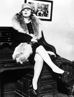 American actress. Mae West seated on a desk during the obscenity trial for her play