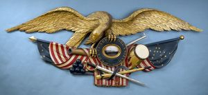AMERICAN EAGLE, 1855. Wooden American eagle and flag, 1855.