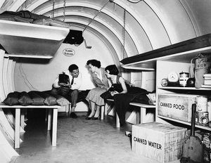 An American family in a backyard bomb shelter, Garden City, New York, 1955.