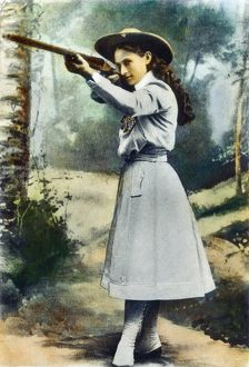 ANNIE OAKLEY (1860-1926). American markswoman: oil over a photograph, 1899.