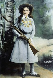 ANNIE OAKLEY (1860-1926). Oil over a photograph, 1899.