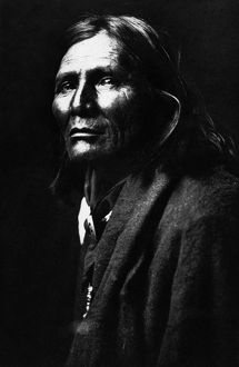 APACHE MAN, 1906. Alchise, an Apache Native American man. Photographed by Edward S