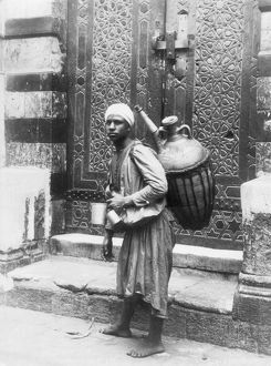 ARAB WATERBOY, c1900. Photograph