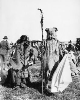 ASSINIBOIN DANCERS, 1906. Two Assiniboin boys wearing the costumes of a leader