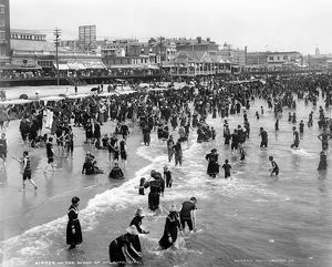 ATLANTIC CITY: BEACH. A view of the shoreline with crowds of people bathing in the water