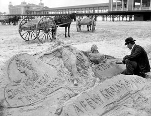 ATLANTIC CITY: THE SANDMAN. A man making sculptures and messages in the sand on the