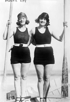 ATLANTIC CITY: WOMEN. Two young women wearing swimsuits in a standing pose at the beach