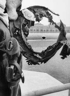 ATTICA PRISON RIOT, 1971. The burned hat of a prison guard frames a bullet hole in