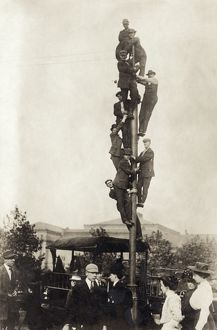 BASEBALL: SPECTATORS, 1909. Spectators on a utility pole at a World Series game
