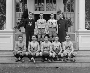 BASKETBALL TEAM, 1920. Portrait of the Yankee basketball team. Photograph, 1920