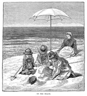 BEACH SCENE, 1879. 'On the Beach.' Wood engraving.