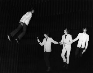 THE BEATLES, 1964. The Beatles 'fly' above the stage during a rehearsal for
