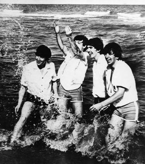 THE BEATLES, 1964. The Beatles playing in Lake Erie during a trip to Cleveland, Ohio