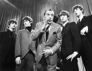 BEATLES AND ED SULLIVAN. The Beatles photographed on the set of 'The Ed Sullivan