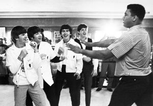The Beatles (from left: Ringo Starr, John Lennon, George Harrison, and Paul McCartney) clowning with boxer Cassius Clay (later Muhammad Ali) at his training camp in Miami Beach, Florida, 18 February 1964, one week prior to his heavyweight championship fight with Sonny Liston.