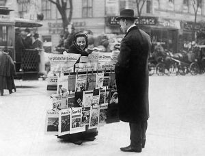 BERLIN: NEWSPAPER SELLER. A woman selling newspapers on the street in Berlin, Germany