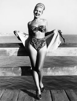 Bette Alden models a three-piece bathing suit designed by Ruth Small of Long Beach, California
