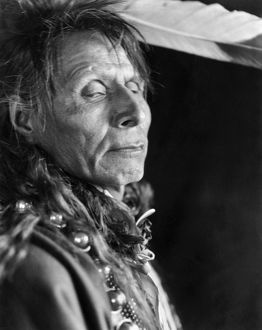 BLACK CROW, 1913. Portrait of Black Crow, a Hidatsa Native American, photographed