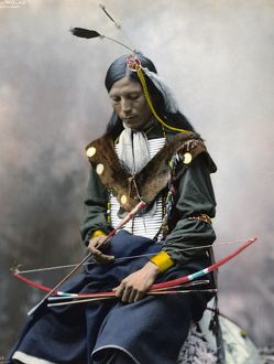 BONE NECKLACE, c1899. Oglala Sioux chief. Hand colored platinum print photograph, c1899